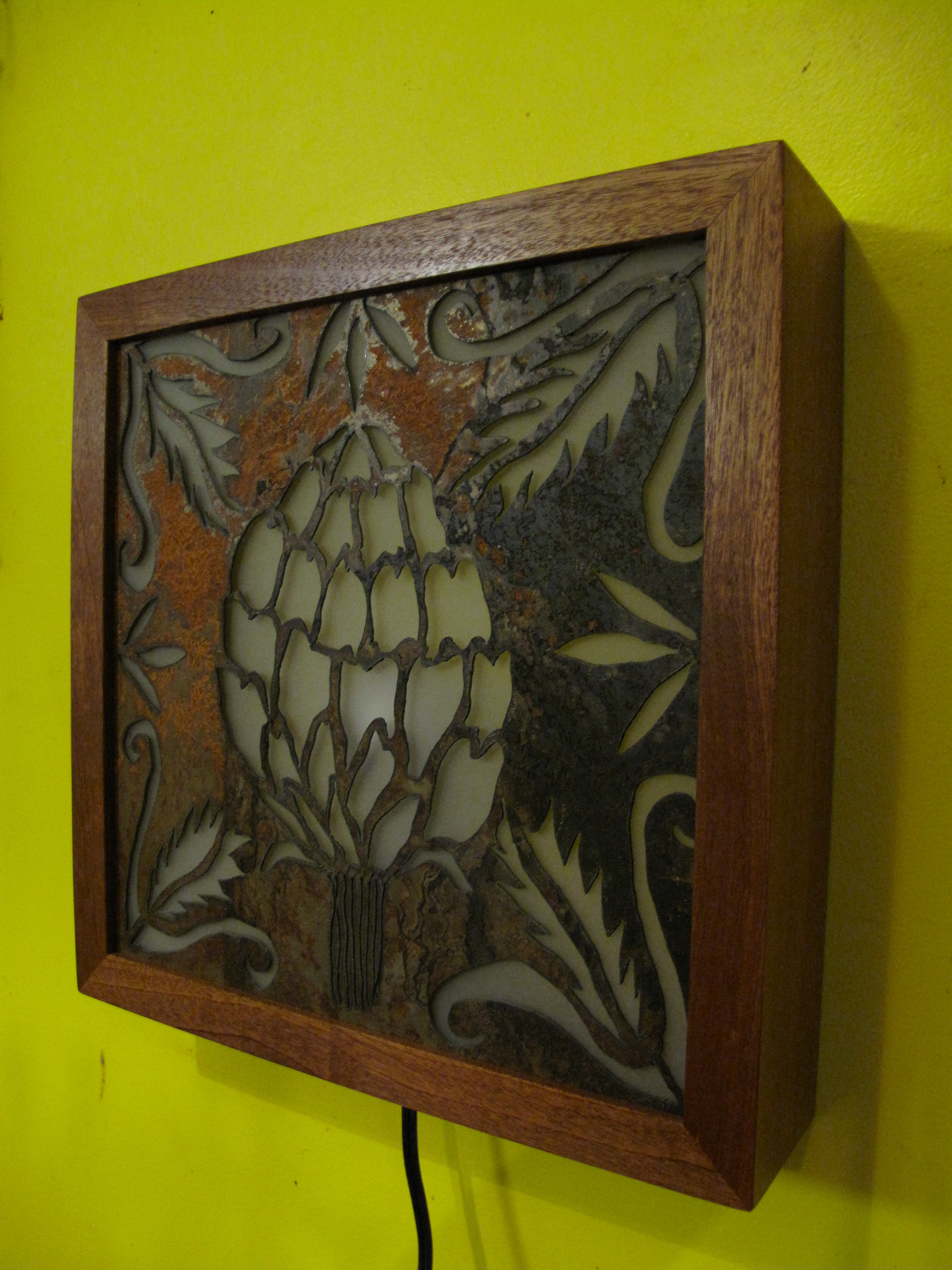 Artichoke by Elsa Hoffman - Plasma cut steel - sapele wood - plexiglass - light bulb - 13x13x3.5 - 2014 300.00